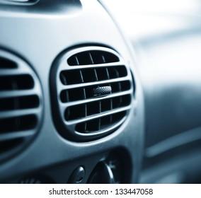 car interior.air conditioner. very shallow DOF. blue tone