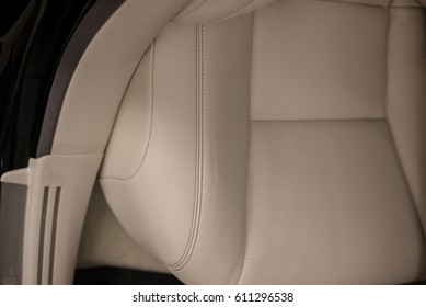 Car interior detail. Leather seat with stich.