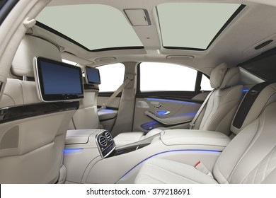 Car interior luxury. Interior of prestige modern car. Leather comfortable seats, multimedia & panoramic rooftop. White cockpit with exclusive wood & metal decoration on isolated white background.