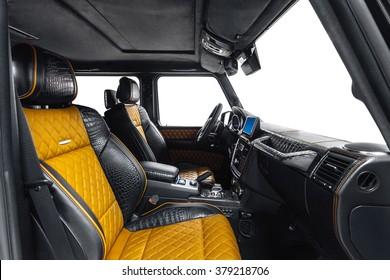 Car interior luxury. Interior of prestige modern car. Crocodile leather comfortable seats, dashboard & steering wheel. Black cockpit on isolated white background