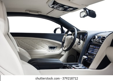 Car interior luxury. Interior of prestige modern car. Dashboard & steering wheel. White cockpit with exclusive on isolated white background.