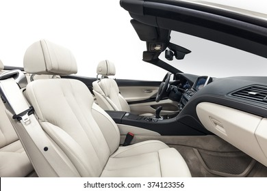 Car interior luxury service. Cabriolet white seats & black dashboard