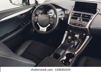 car interior. Modern car speedometer and illuminated dashboard. Luxurious car instrument cluster. Close up shot of car instrument panel.
