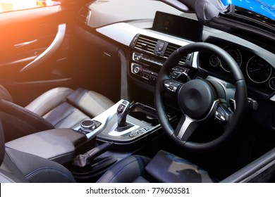 car interior. Modern car speedometer and illuminated dashboard. Luxurious car instrument cluster. Close up shot of hybrid car instrument panel