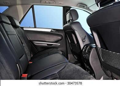 car interior, passenger places with leather and suede sofa