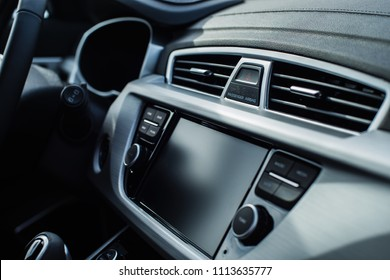 car interior with shallow depth of field with focus on the emergency stop button