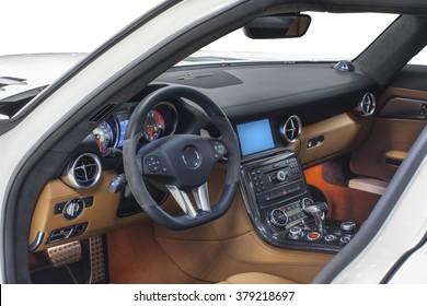 Car interior sports. Interior of prestige modern car. Leather comfortable seats, dashboard & steering wheel. Orange cockpit with exclusive carbon & metal decoration on isolated white background.