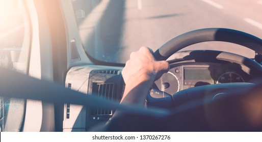 Car interior and steering wheel, Driving on the road with safety belt