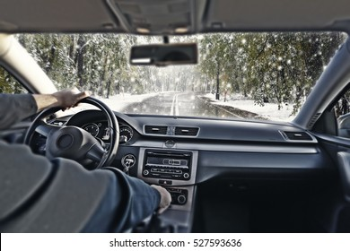 car interior and winter road with snow