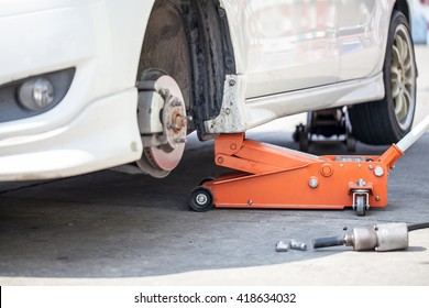 Car jack to lift car, changing car tire