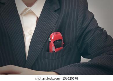 Car in a jacket pocket (concept)
