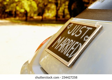 Car with just married sign in a blackboard