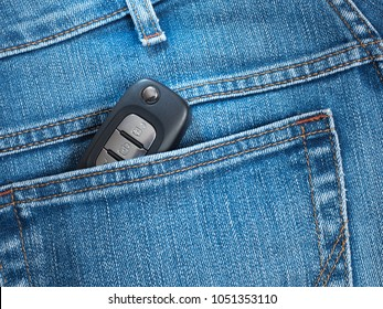 The car key in back pocket of jeans