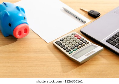 Car key and Calculator and piggy bank and pen on paper blank page for business finance backgrounds