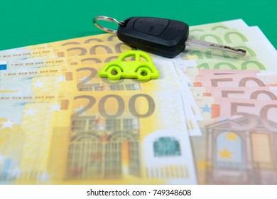car key and euro money on a green carpet
