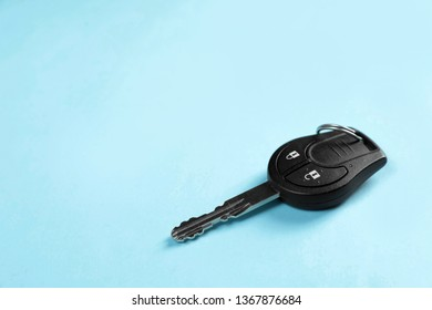 Car key on color background. Space for text