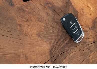car key on wooden table