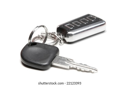 Car key and remote control on white ground