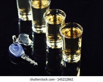 car keys in the foreground and a whiskey shots