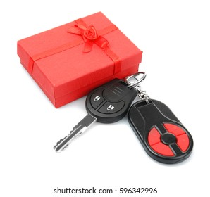 Car keys and gift box on white background