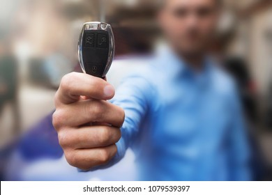 Car Keys. The hand of man presents the keys.