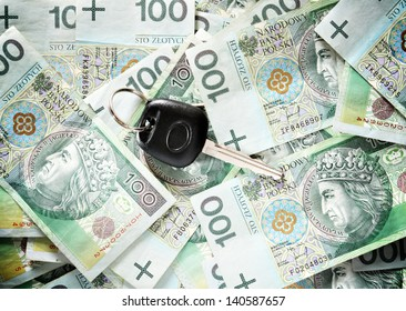 Car keys on a background of banknotes