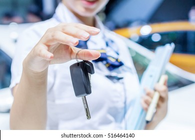 Car Keys. Seller hand giving keys