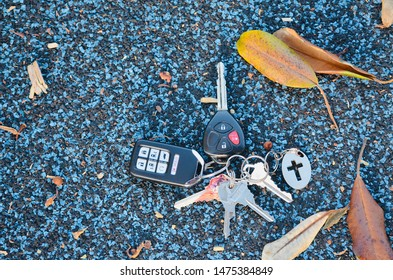 Car keys with silver cross key chain on rubber background can use for Christian as a symbol that Jesus is the key of life