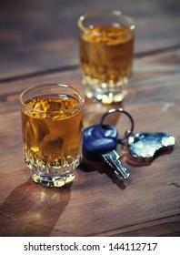 car keys and a whiskey shot