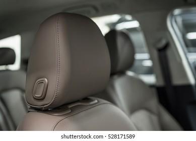 Car leather headrest. Interior detail.