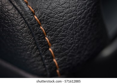 Car leather texture with stitch. Interior detail. Macro photo.