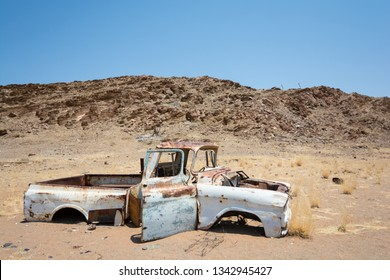 Car left a long time ago, dented and rusted, in absolute solitude of Damaraland, Namibia, Africa.