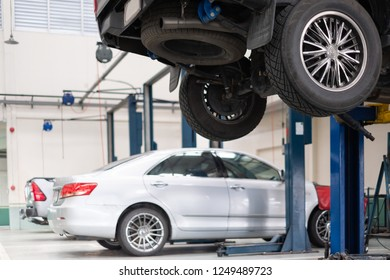 Car lift up for repair at car repair service shop