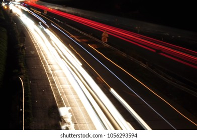 Car light lines on a highway during trafic jam at night, can be used as background image, red  and yellow car lights.