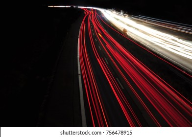 Car light lines on a higway during trafic jam at night