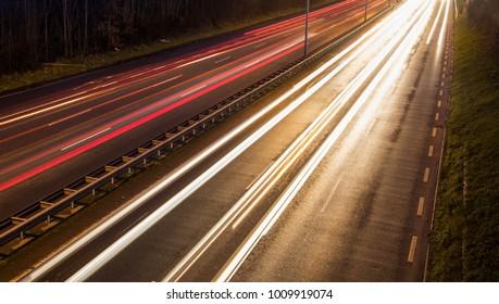 car light streaks motion blur on the highway
