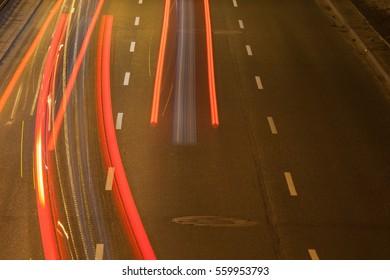 Car light trace over asphalt