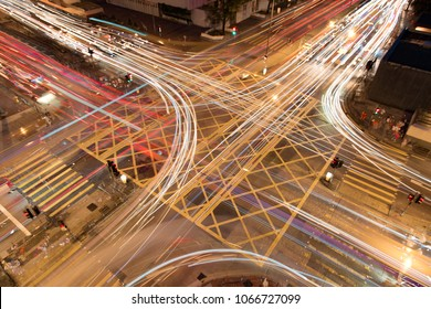 The car light trails in the city intersection