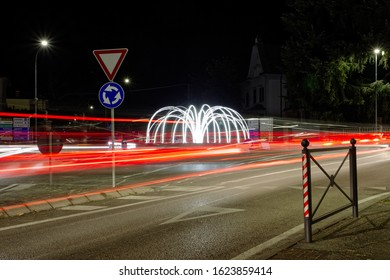 Car light trails in a crossroad in Italy