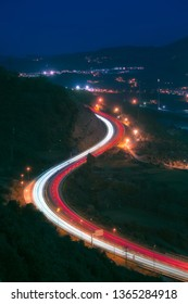 Car light trails in highway at night