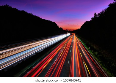 Car light trails. Lights on the highway. Traces of cars. Abstract light, Lichtschweife. Highway at sunset and lots of traffic. Highway at night.