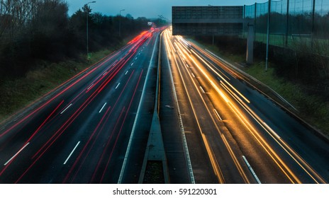 Car light trails on the highway in the early morning pre-dawn light