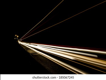 Car light trails on the road, movement of trucks