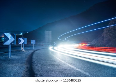 car light trails on serpentine road