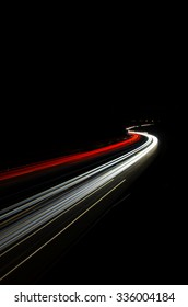 Car light trails, of traffic on the move at street, urban landscape. Art image, photo taken using exposure