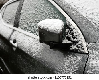 car lightly covered in snow