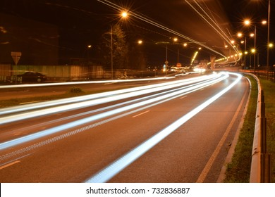 Car lights by the highway