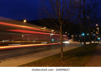 Car lights at night, long exposure photo of traffic