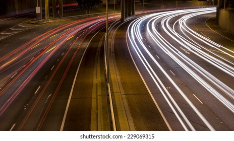 Car lights at night on a freeway, using a long exposure.