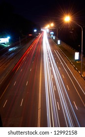 Car lights on highway in the night